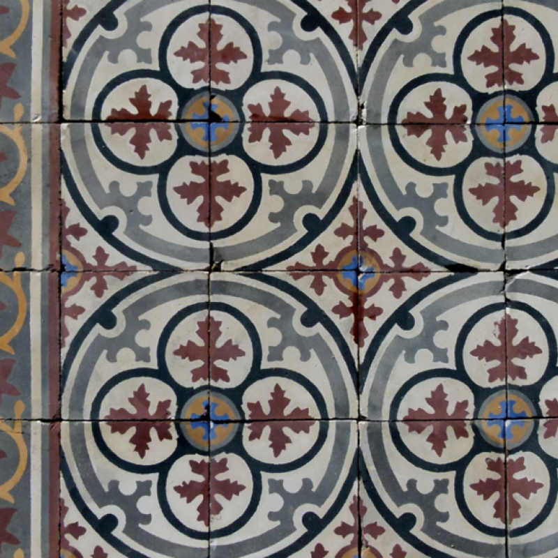 A cleaned section of an antique carreaux de ciments floor of 20cm sq tiles