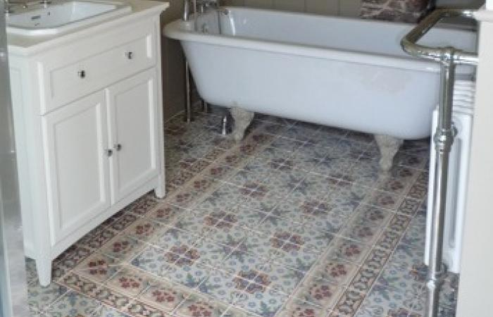 A pretty, floral antique ceramic floor in a Devon Cottage