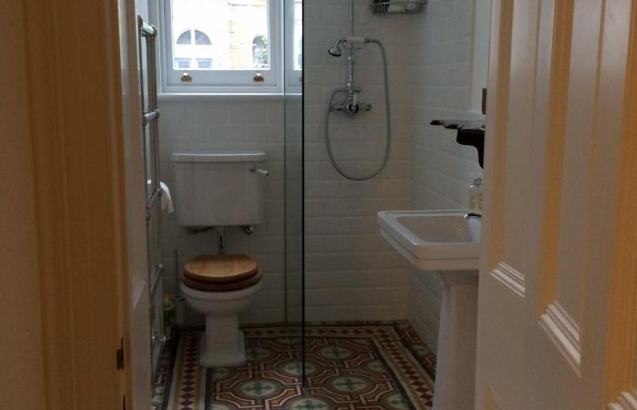 Two antique carreaux de ciment floors adding warmth and colour in this North London home.