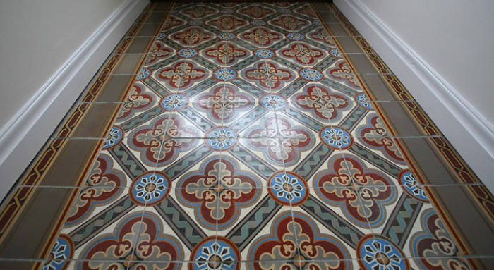 The antique Paray le Monial ceramic tile now relaid in our clients entrance hallway